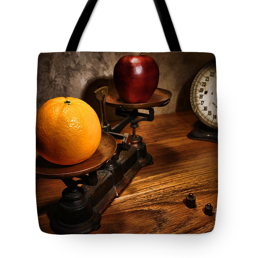 Orange Tote Bag featuring the photograph Comparing Apple And Orange by Olivier Le Queinec