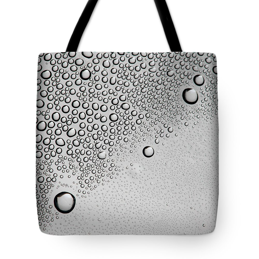 Part Of A Series Tote Bag featuring the photograph Condensation On A Shiny Surface by Larry Washburn