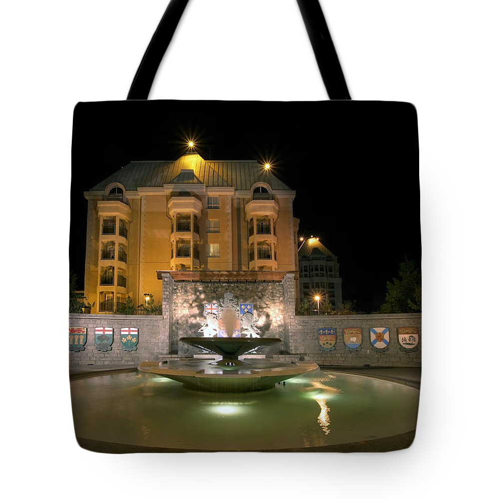 Confederation Tote Bag featuring the photograph Confederation Fountain In Victoria Bc With Code Of Arms by Jit Lim