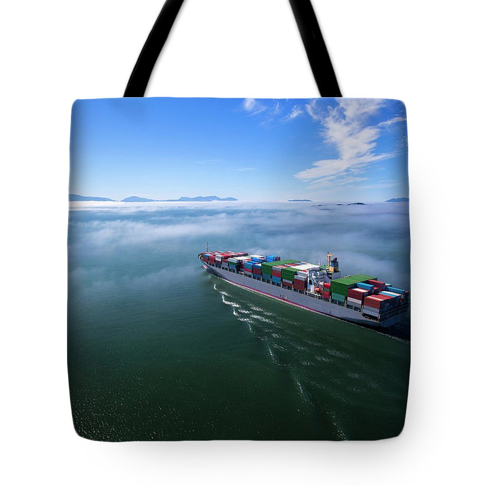 Freight Transportation Tote Bag featuring the photograph Container Ship by Dan prat