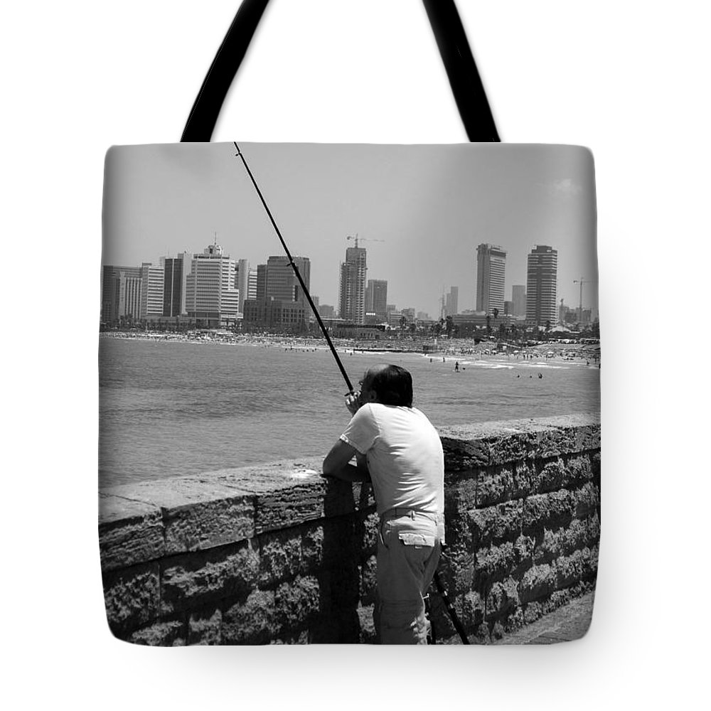 Fishing Tote Bag featuring the photograph Contemplative Fisherman In Tel Aviv by Joshua Van Lare