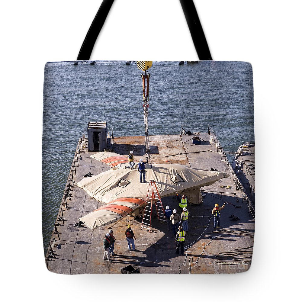 Military Tote Bag featuring the photograph Contractors Hoist The X-47b Unmanned by Stocktrek Images