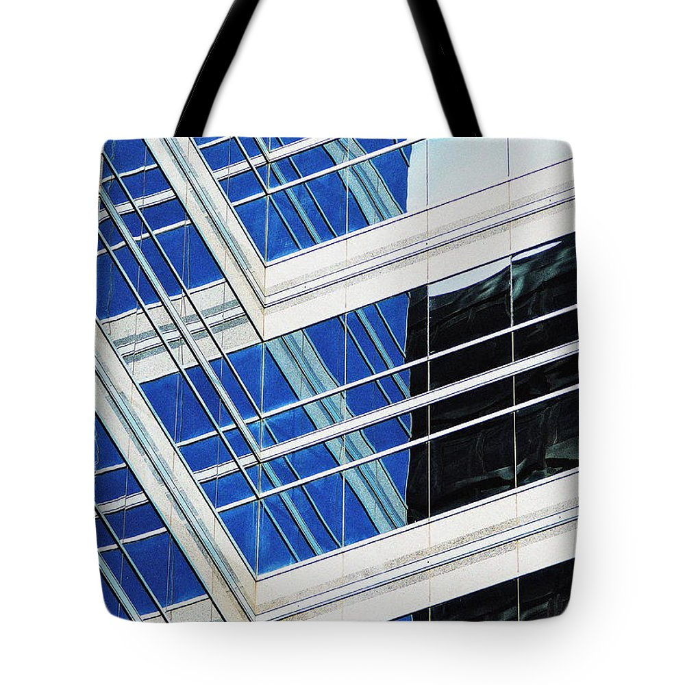 Skyscrapers Tote Bag featuring the photograph Contrasting Elements by Ira Shander