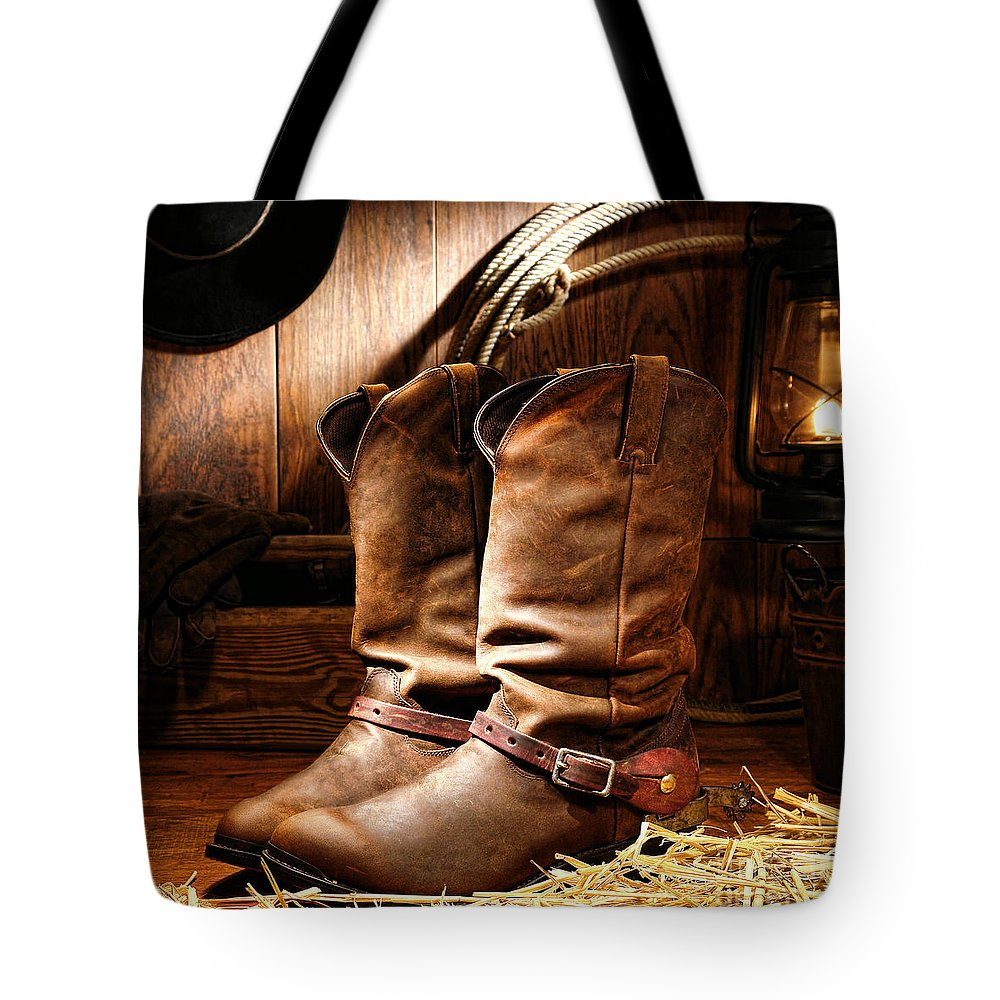 American Tote Bag featuring the photograph Cowboy Boots In A Ranch Barn by American West Decor By Olivier Le Queinec