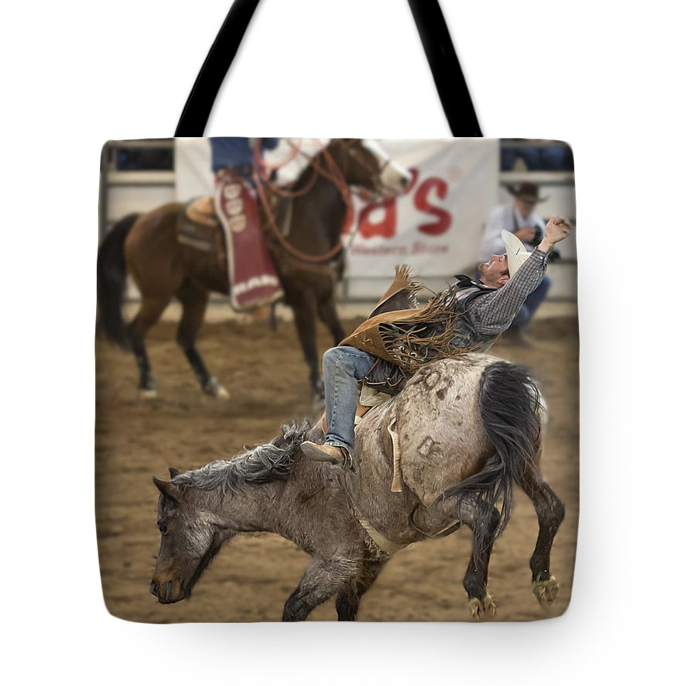 Arizona Tote Bag featuring the photograph Cowboy Hang On by James Gordon Patterson
