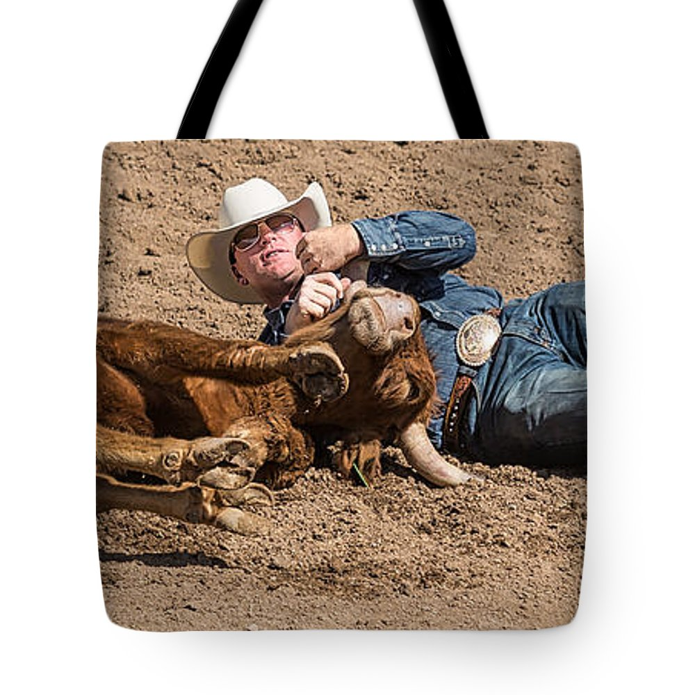 Arizona Tote Bag featuring the photograph Cowboy Has Steer By Horn by James Gordon Patterson