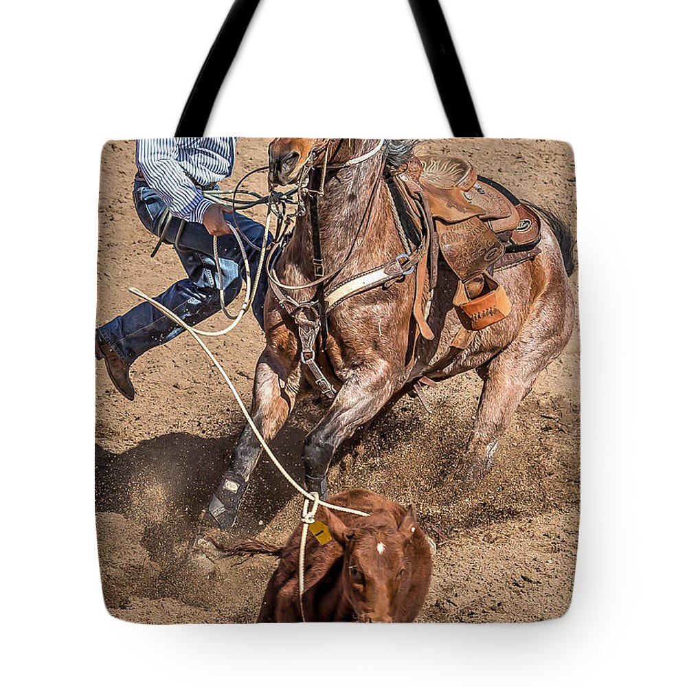 Arizona Tote Bag featuring the photograph Cowboy Ropes Calf by James Gordon Patterson