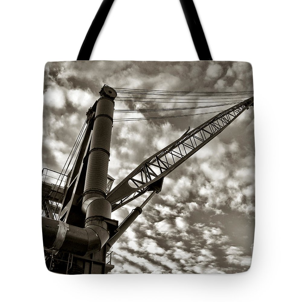 Crane Tote Bag featuring the photograph Crane by Olivier Le Queinec
