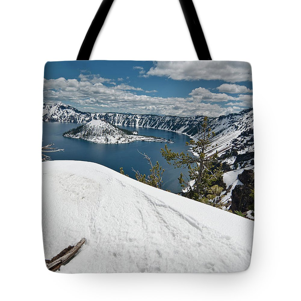 Crater Lake Tote Bag featuring the photograph Crater Lake And Wizard Island In June by Greg Nyquist