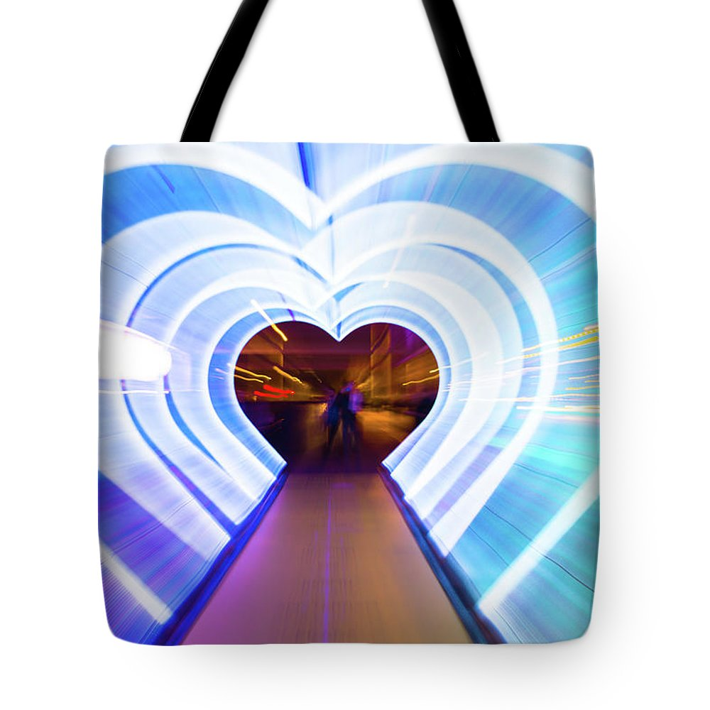 Cool Attitude Tote Bag featuring the photograph Creative Picture With Zoom Technique Of by Artur Debat