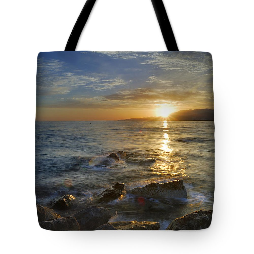 Water Tote Bag featuring the photograph Crepuscular Rays At The Sea by Guido Montanes Castillo