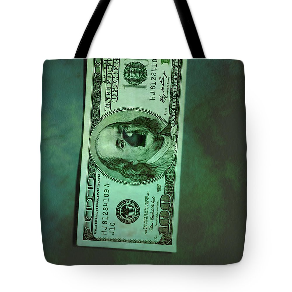 Money; Bill; Us; United States; United States Of America; America; 100; Dollars; Currency; Wealth; Rich; Bullet; Hole; Broke; Broken; Bankrupt; Bankruptcy; Crime; Thriller; Mystery; Mysterious; Ominous; Foreboding; Green; Greenback; Dark; Darkness; Hundred; Damaged; Destroyed; Rip; Ripped Tote Bag featuring the photograph Crime by Margie Hurwich