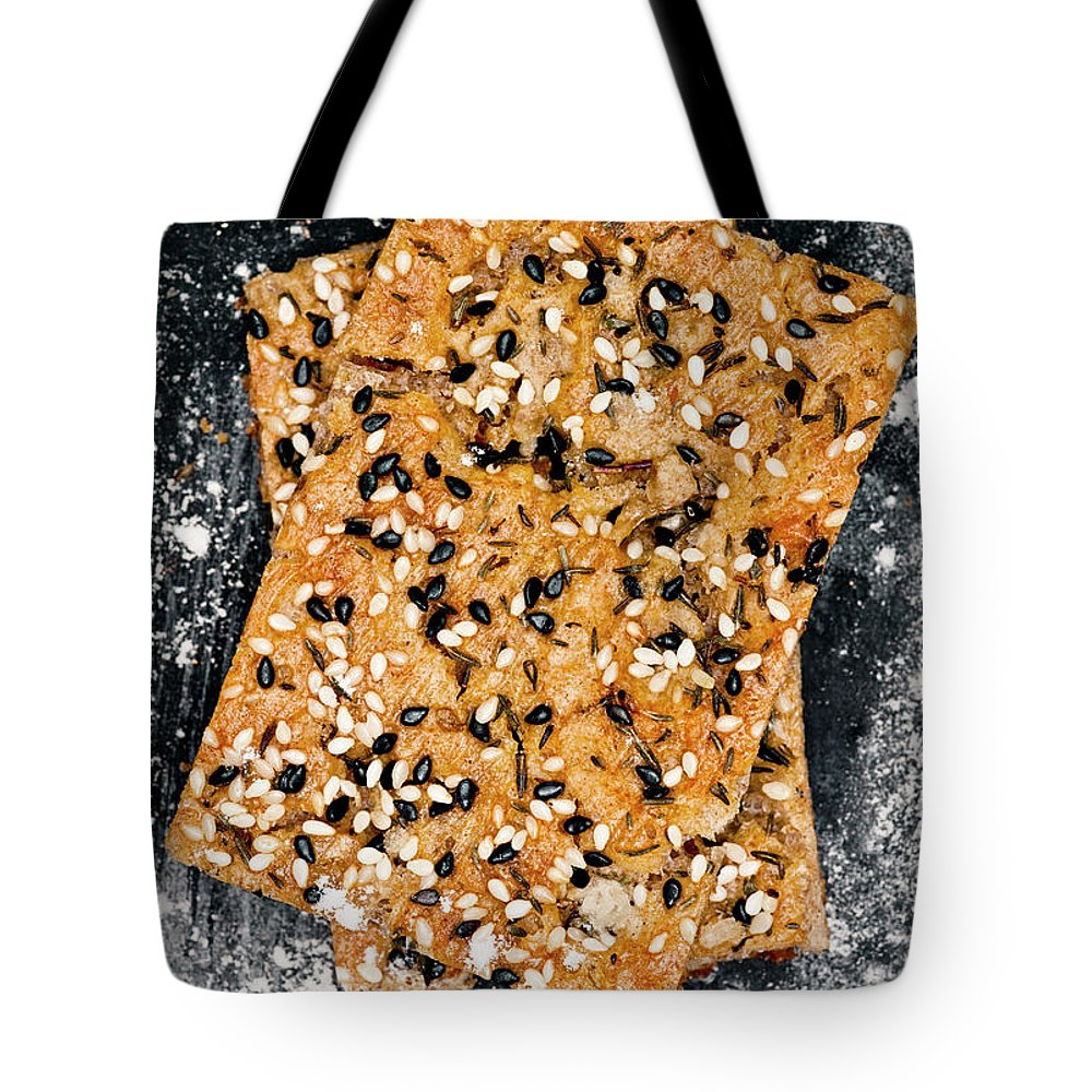 Sweden Tote Bag featuring the photograph Crispbread With Thyme On Metal Sheet by Johner Images