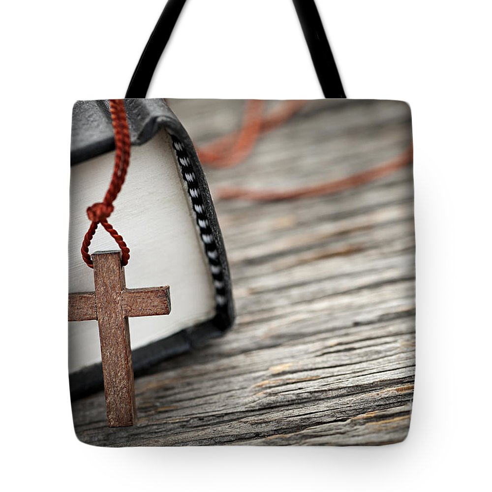 Cross Tote Bag featuring the photograph Cross And Bible by Elena Elisseeva