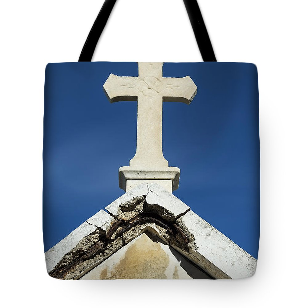 Cemetery Tote Bag featuring the photograph Cross by John Greim