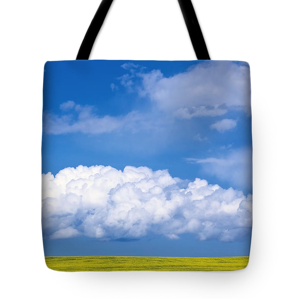 White Tote Bag featuring the photograph Cumulus Clouds Building Over Canola by Ken Gillespie