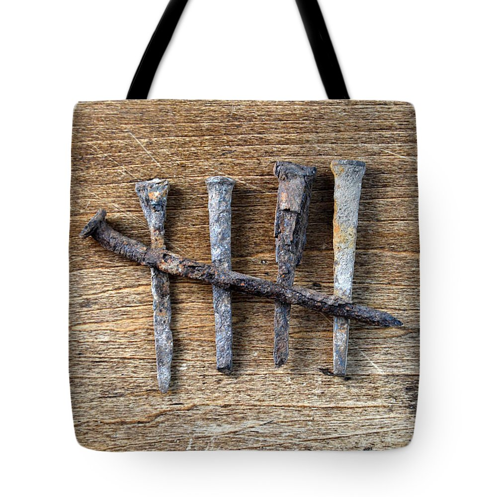 Nail Tote Bag featuring the photograph Counting With Old Nails by Jill Battaglia