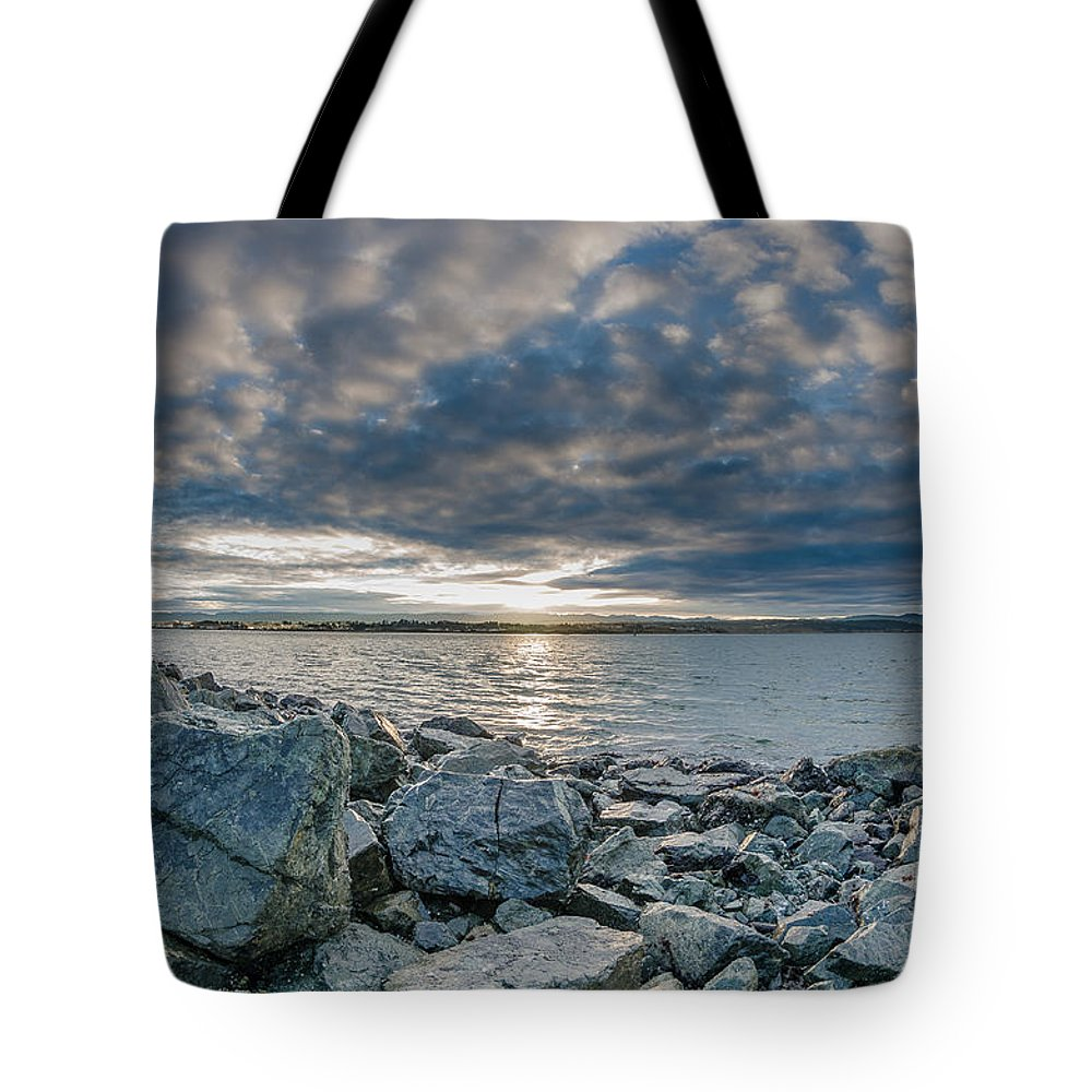Sunrise Tote Bag featuring the photograph Curve Off The Bay by Greg Nyquist