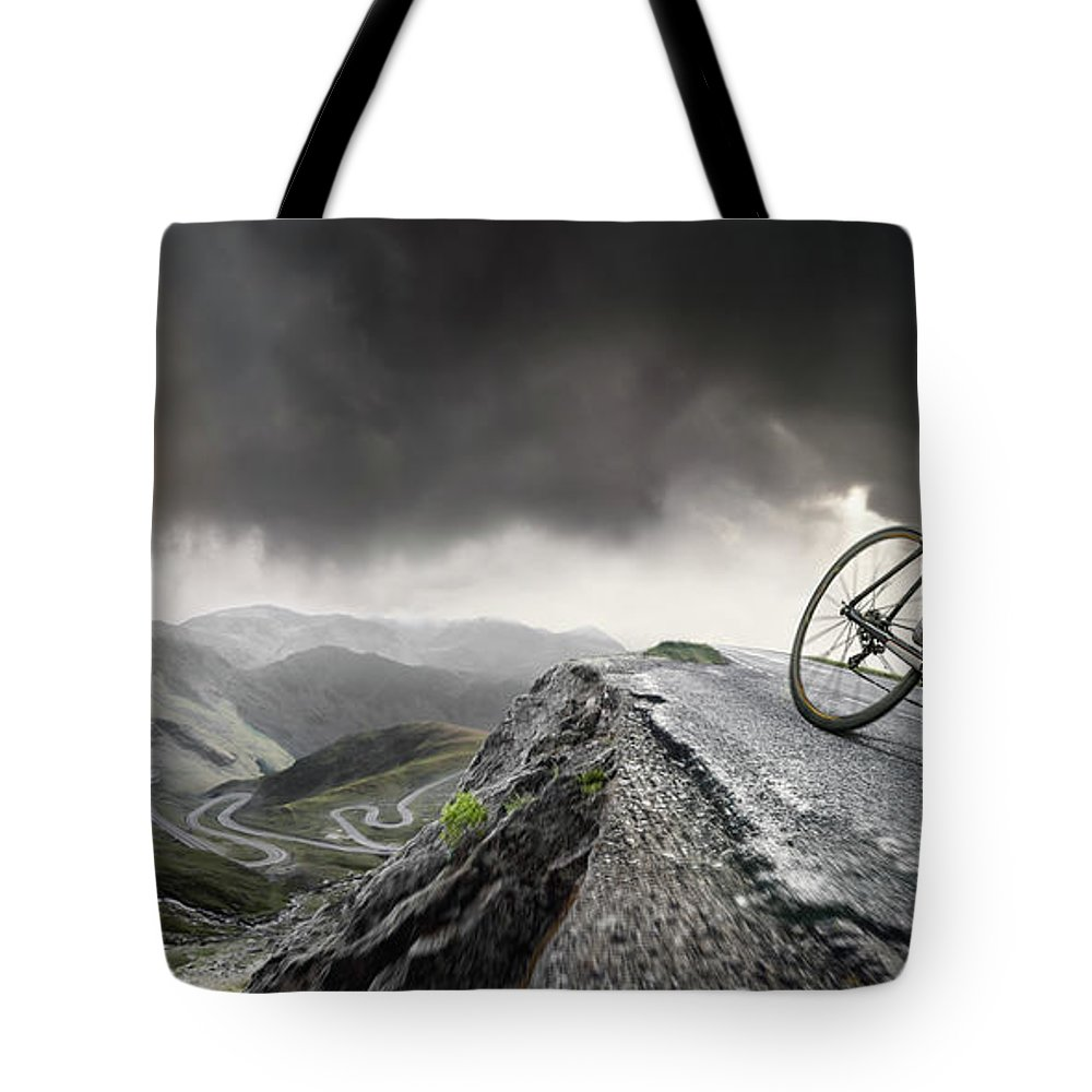Sports Helmet Tote Bag featuring the photograph Cyclist Climbs To The Top by Peepo