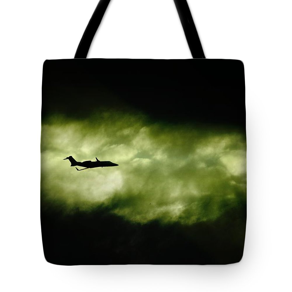 Learjet Tote Bag featuring the photograph Dark Shadow by Paul Job