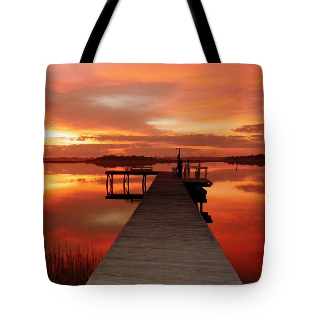 Orange Waterscapes Tote Bag featuring the photograph Dawn Of New Year by Karen Wiles
