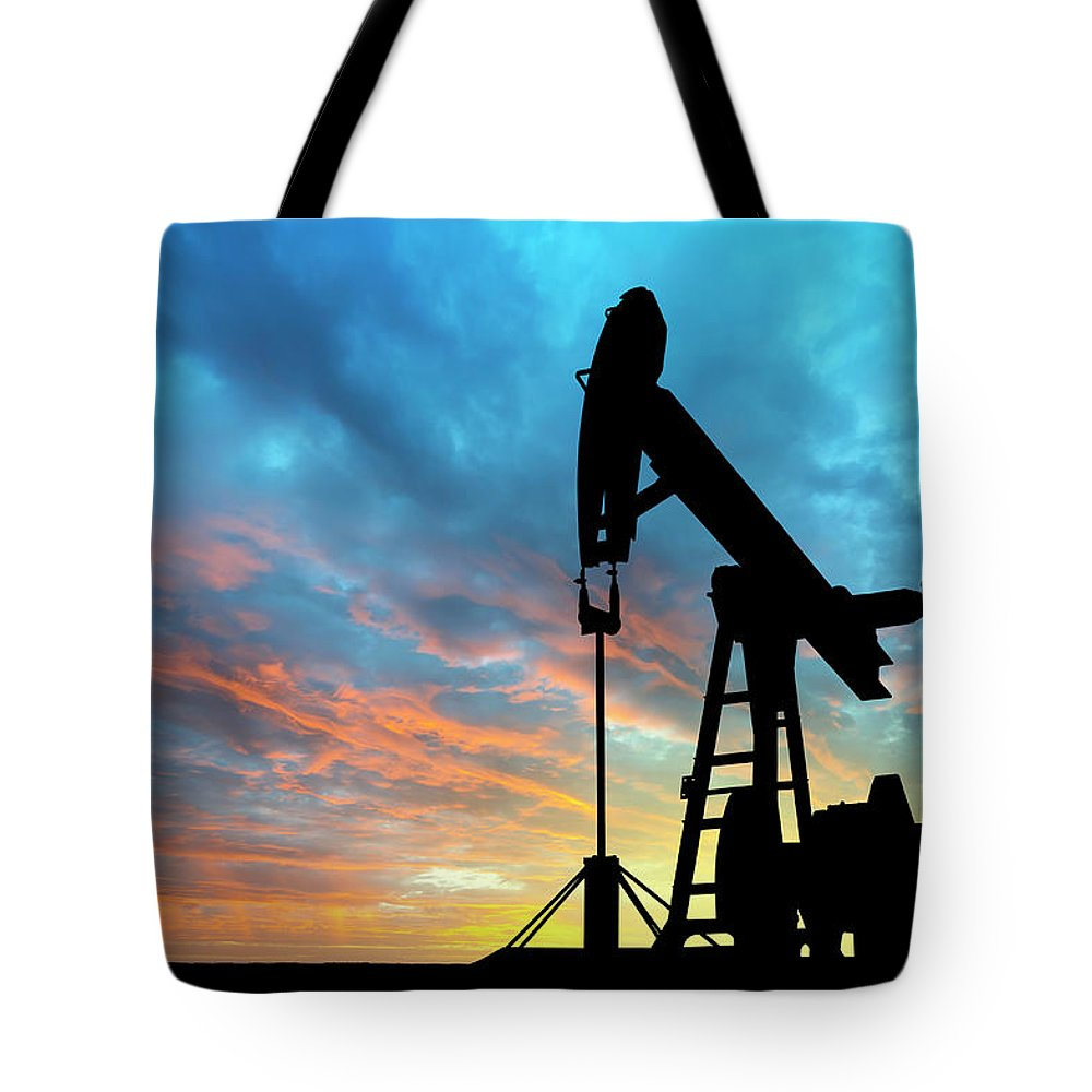 Shadow Tote Bag featuring the photograph Dawn Over Petroleum Pump by Grafissimo