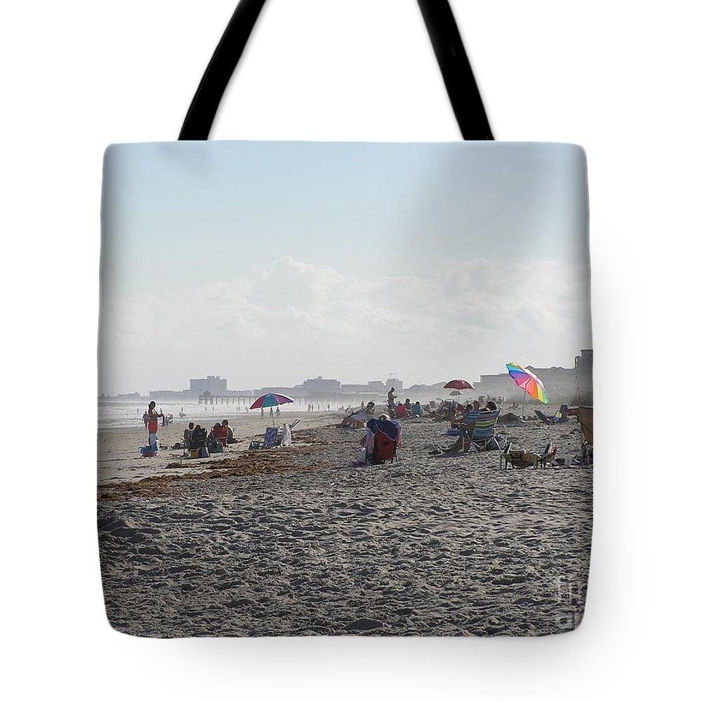 Sea Tote Bag featuring the photograph Day At The Beach by Donna Spencer