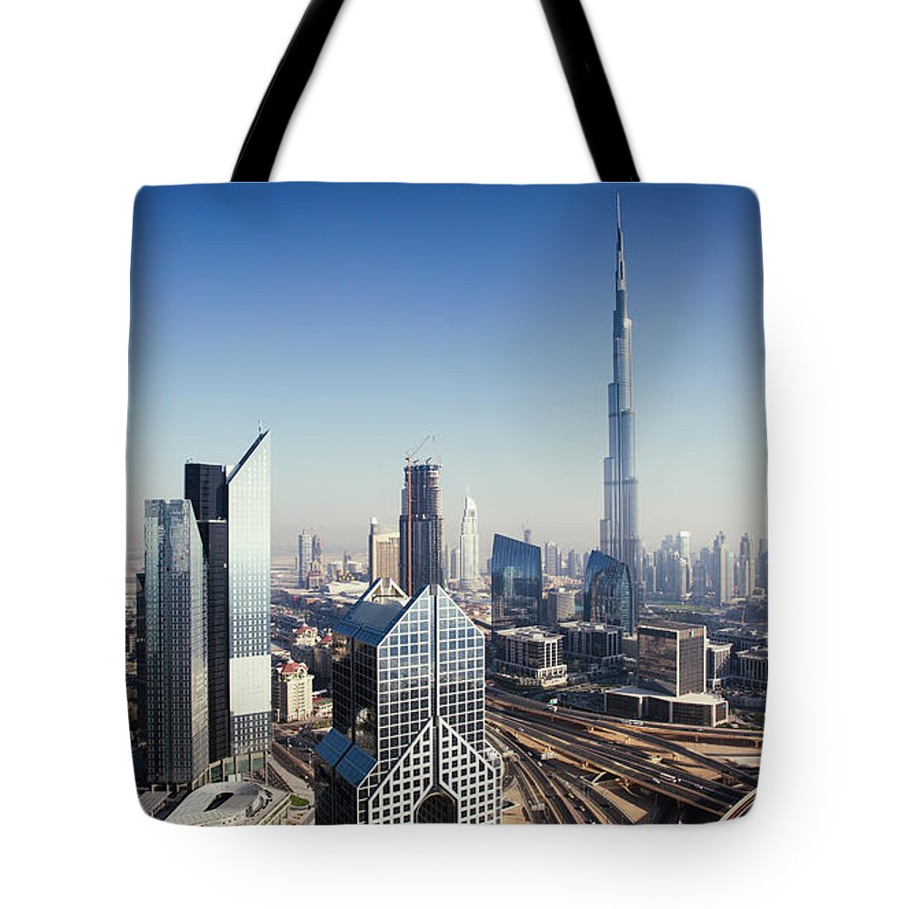 Downtown District Tote Bag featuring the photograph Dbuai Sky Line With Traffic Junction by Tempura