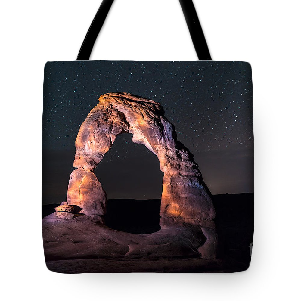 Moab Tote Bag featuring the photograph Delicate Arch At Night Against Beautiful Night Sky by Krzysztof Wiktor
