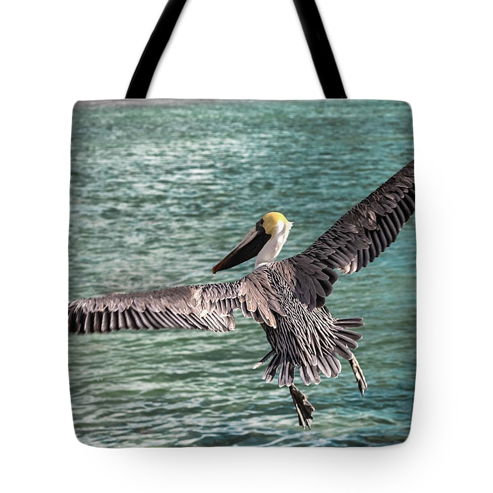 Pelicans Tote Bag featuring the photograph Delight In Flight by Karen Wiles