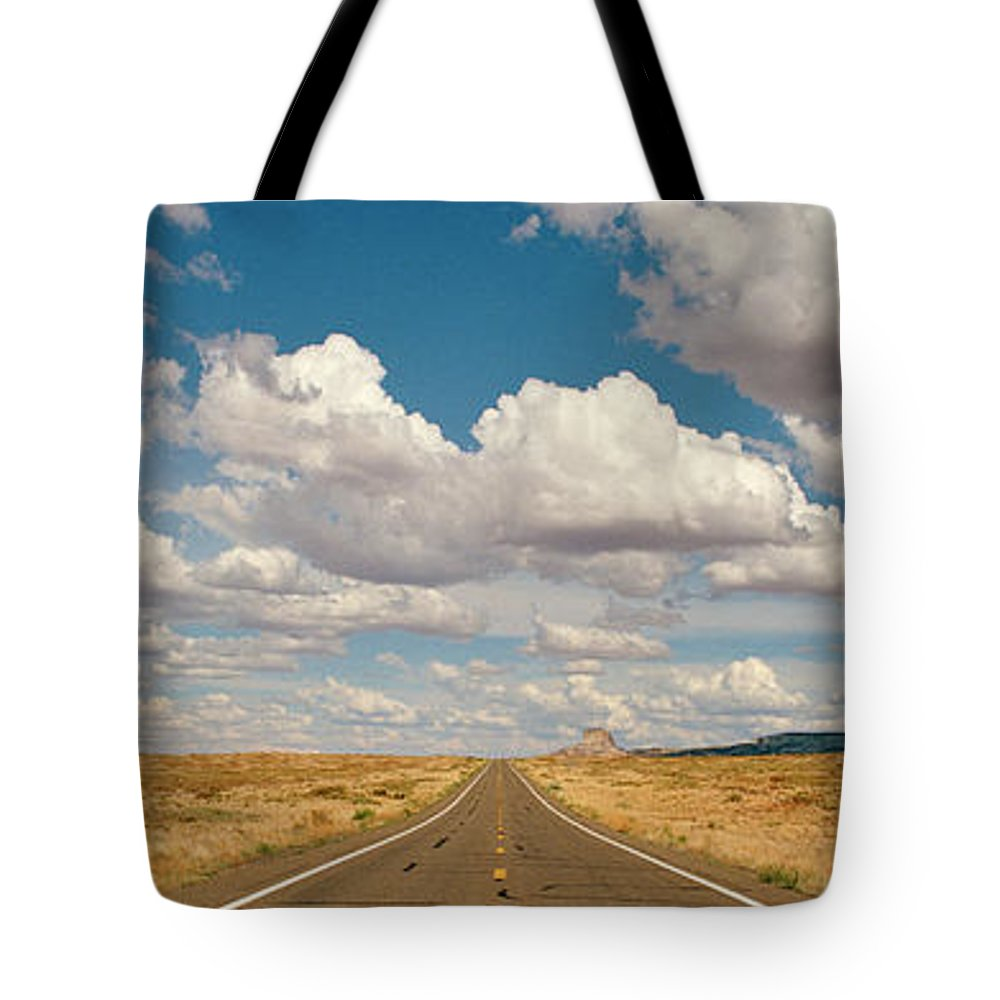 Scenics Tote Bag featuring the photograph Desert Road With Cloud Formations Above by Gary Yeowell