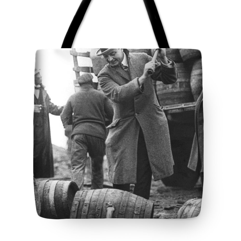 1920's Tote Bag featuring the photograph Destroying Barrels Of Beer by Underwood Archives
