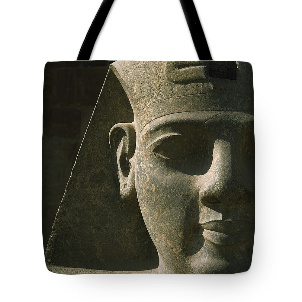 Cumming Tote Bag featuring the photograph Detail Of Pharaoh Head At Entrance by Ian Cumming