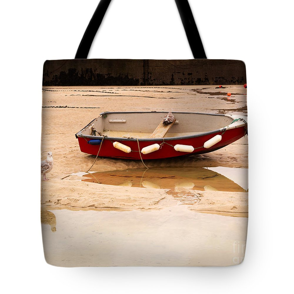 Beached Dinghy Tote Bag featuring the photograph Dinghy At Low Tide In St Ives Cornwall by Louise Heusinkveld