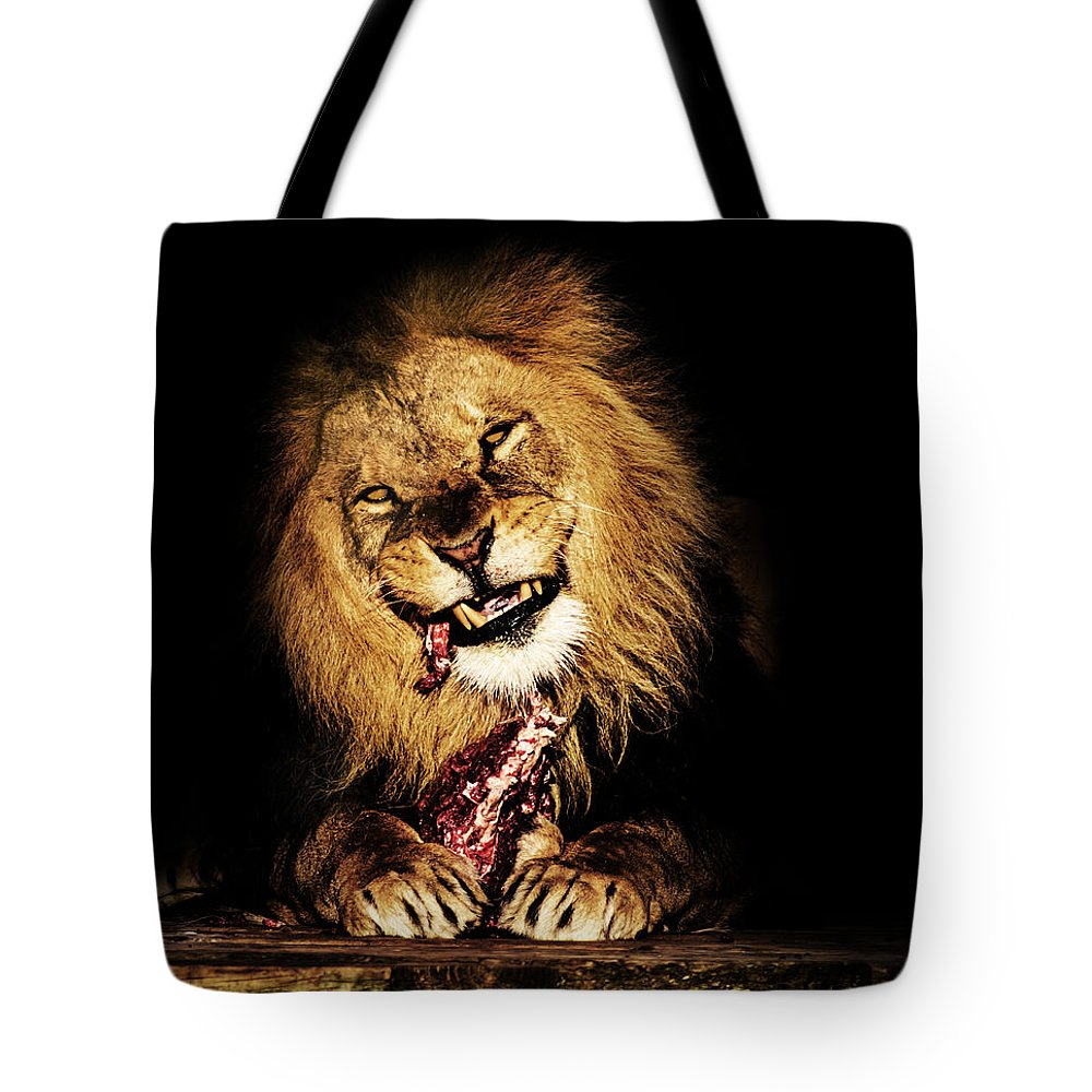 Lion Tote Bag featuring the photograph Dinner Time by Martin Newman