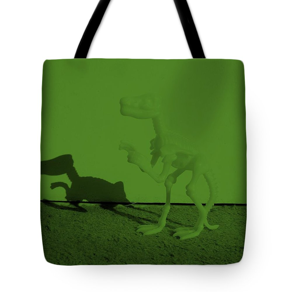 Dinosaur Tote Bag featuring the photograph Dino Olive by Rob Hans