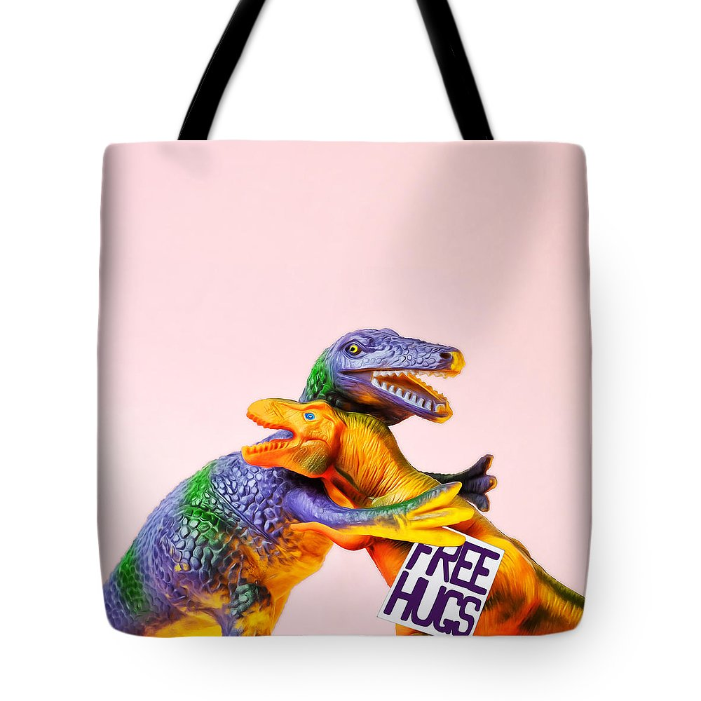 Fun Tote Bag featuring the photograph Dinosaurs Hugging by Juj Winn