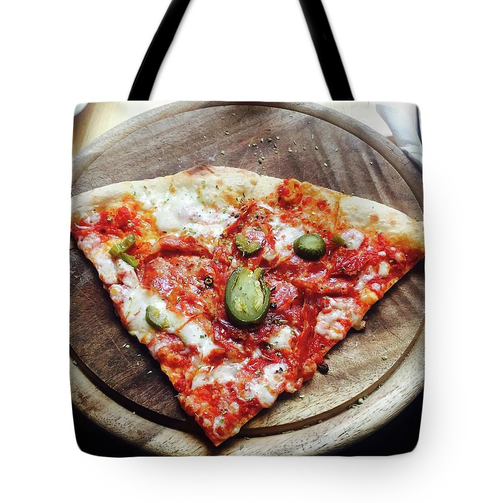 Unhealthy Eating Tote Bag featuring the photograph Directly Above Shot Of Pizza Slice by Svitlana Pavelko / Eyeem