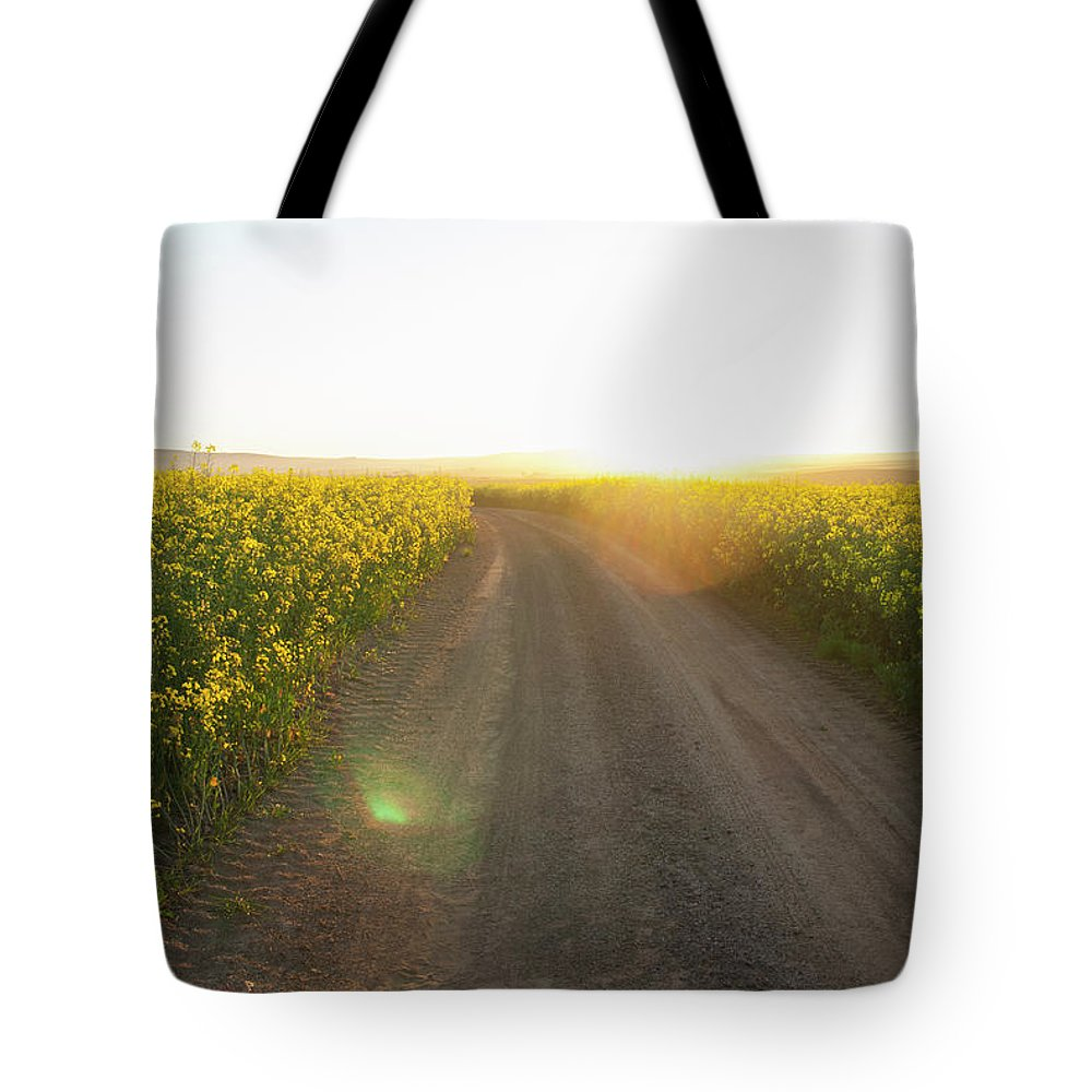 Tranquility Tote Bag featuring the photograph Dirt Road In Field Of Flowers by Luka