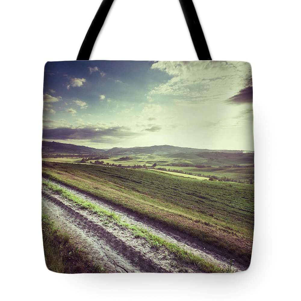 Steppe Tote Bag featuring the photograph Dirt Track In Tuscany by Xavierarnau
