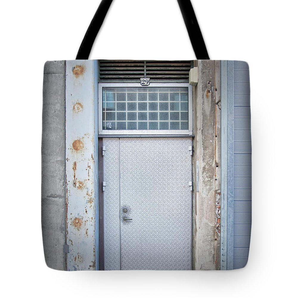 Metal Tote Bag featuring the photograph Dirty Metal Door by Antony McAulay