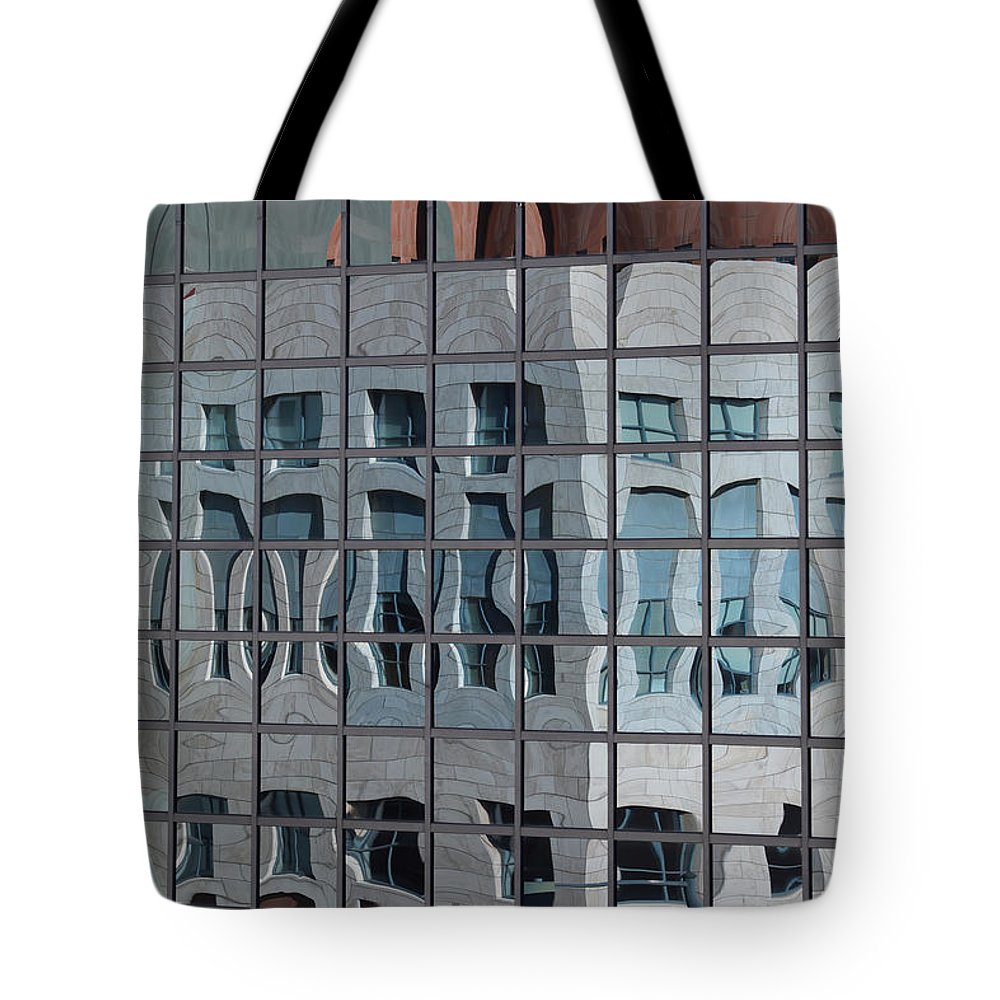 Distorted Reflections Tote Bag featuring the photograph Distorted Reflections by Ernie Echols