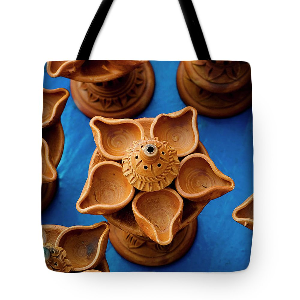 Child's Play Clay Tote Bag featuring the photograph Diya by Tapasbiswasphotography
