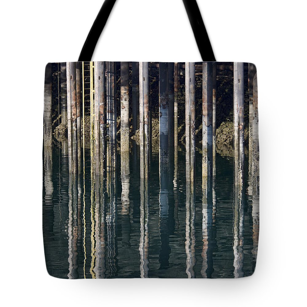 Dock Pilings Tote Bag featuring the photograph Dock Pilings by David Arment