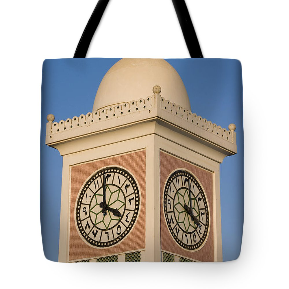 Capital Cities Tote Bag featuring the photograph Doha Clocktower by Charles Bowman