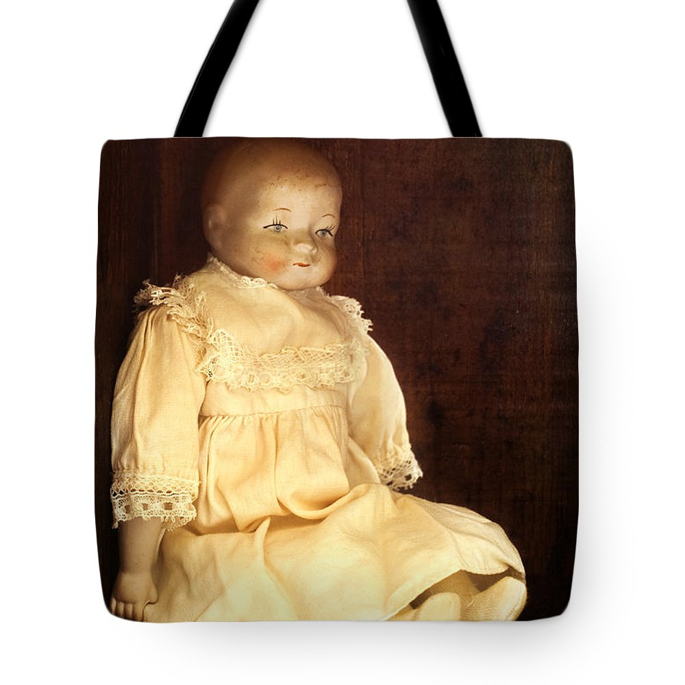 Antique; Childhood; Dirty; Doll; Alone; Shelf; Dress; Eyes; Face; Gazing; Heirloom; Nostalgia; Old; Staring; Toy; Vintage; Dark; Creepy; Female; Porcelain; Girl; Lace; Socks Tote Bag featuring the photograph Doll Shop by Margie Hurwich