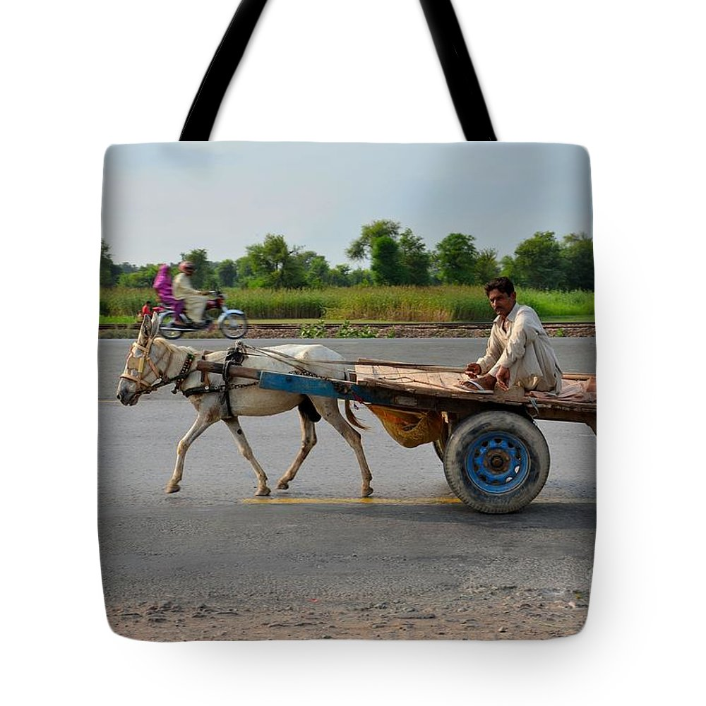 Donkey Tote Bag featuring the photograph Donkey Cart Driver And Motorcycle On Pakistan Highway by Imran Ahmed