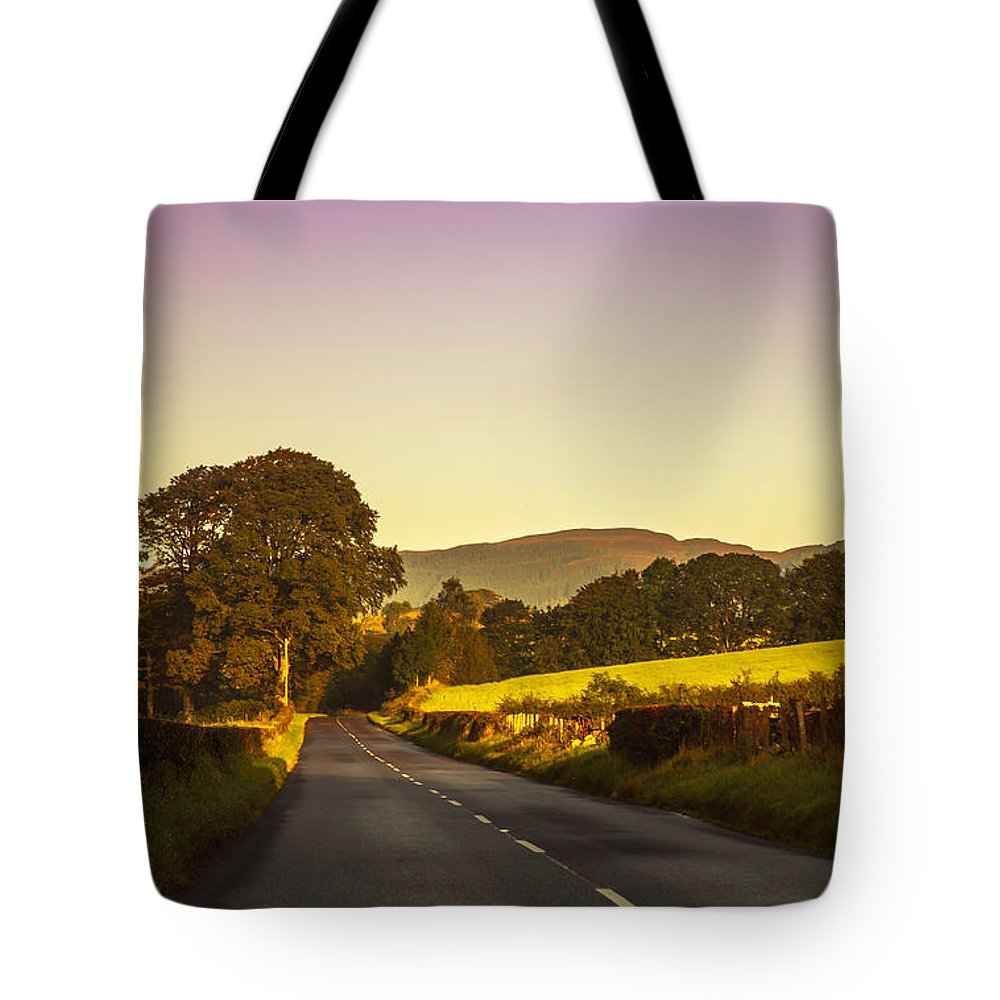 Scotland Tote Bag featuring the photograph Down By The Road. Scotland by Jenny Rainbow