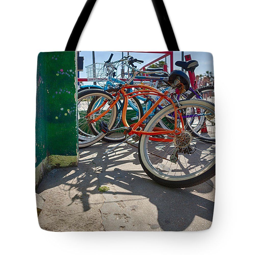 Bicycle Tote Bag featuring the photograph Down Spout And Bikes by Scott Campbell