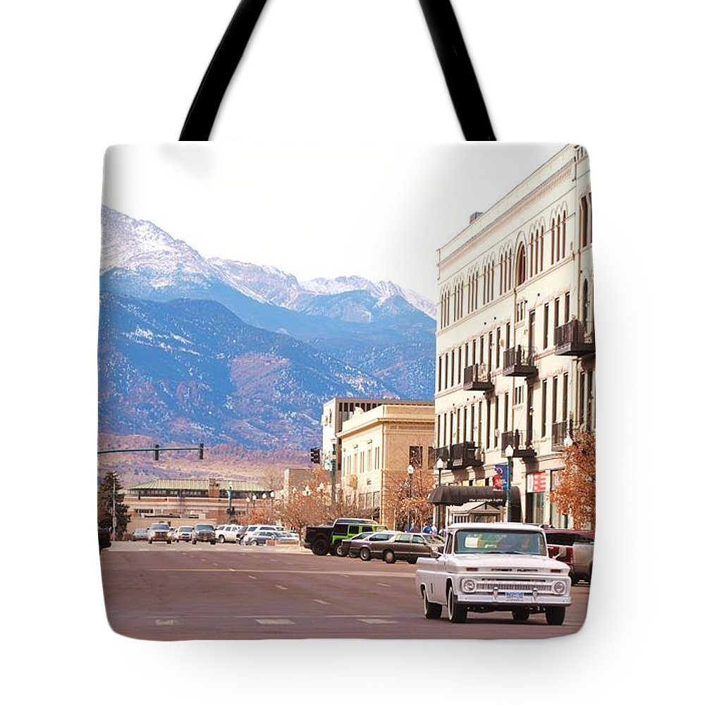 Colorado Springs; Colorado; Downtown; Main Street; Mountain; Winter; City; Pikes Peak; Old Truck; Vintage Tote Bag featuring the photograph Downtown Colorado Springs Colorado by Tammy Burgess